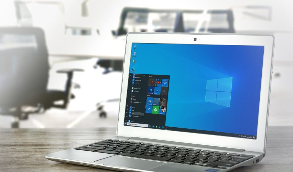 A laptop on a desk showing the desktop of a windows operating system ready to set up Bing Webmaster Tools